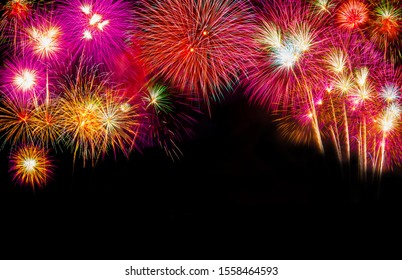 Background dark theme, Beautiful colorful fireworks display on night sky, Amazing holiday fireworks party or any celebration event. Happy new year fireworks celebration