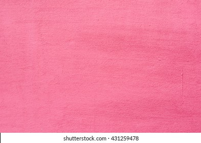 Background of a deep pink (rose-colored) painted wall