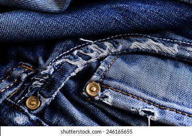 Background of denim blue color with scuffs items