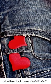 Background of denim with decorative red hearts textiles