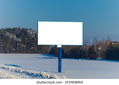 Background for design. Advertising billboard along the road in the city on a winter sunny day