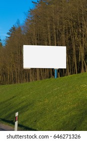Background for design, billboards on city streets and along roadways at sunset
