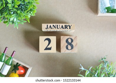 Background Design with number cube strawberry pine apple and wine in natural concept, january 28.