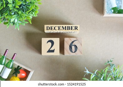 Background Design with number cube tray of fruit and wine in natural concept, December 26.