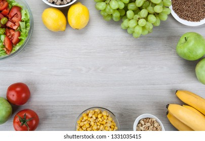 background diet plan with fresh vegetables and fruits on the table top view