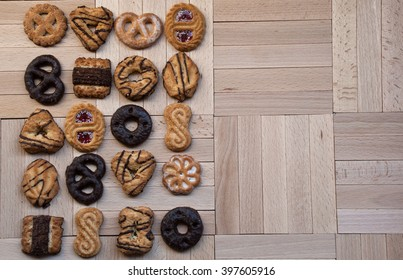 Background with different festive cookies on wooden table