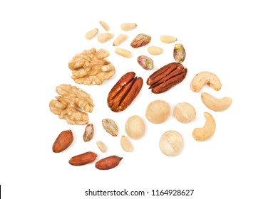 Background of different nuts. Pecan, cashew, macadamia, pistachio, pine nuts, walnuts isolated on white background. Top view.