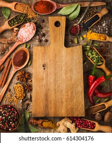 Background with different spices around the cutting board