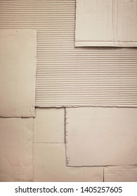 Background and Different texture of the old corrugated cardboard on the wall. Layer of brown packing and recycle paper. Scrap and patch of corrugated paperboard with copy space