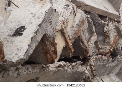Background dismantling of old concrete bridge. The dismantled fragments of reinforced concrete structure are neatly folded. Abstract background perspective elements of reinforced concrete structures. - Shutterstock ID 1342120682