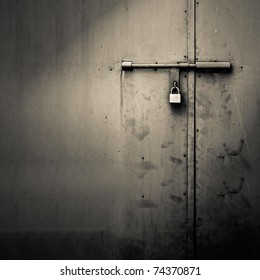 Background of door with lock in metal material and copyspace on wall.