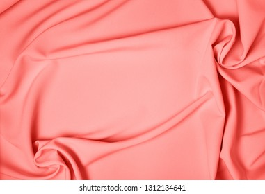 Background drapery fabric closeup. Color of year 2019 Living Coral