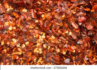 Background of dried chilly pepper flakes