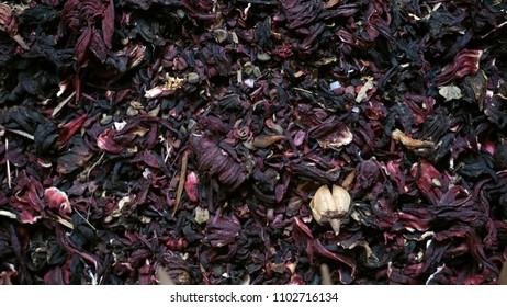 Background of dried Roselle Hibiscus red fruits