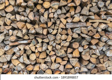 Background of dry chopped firewood logs in a pile, Firewoods Wall Texture.