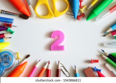 background for education concept scattered pencils and other stationery