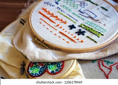 Background with embroidery cloth in embroidery frame, types of embroidery done by hand. Presenting different type of stitches. Embroidery process. Needlework (performed by the author of the images).