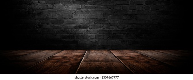 background of an empty black room, a cellar, lit by a searchlight. Brick black wall and wooden floor