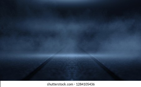 Background of empty dark room with rays of light. Concrete floor with light reflection. Smoke, neon blue light