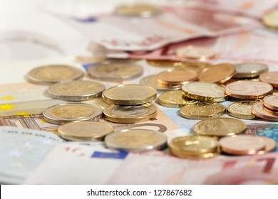 Background of Euro coins and bills