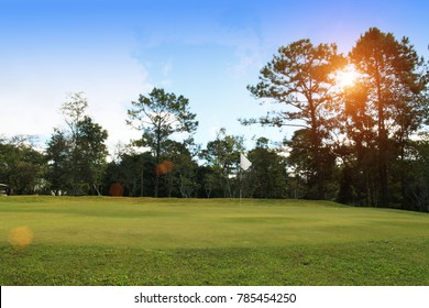 Background evening golf course has sunlight shining down at golf course in Thailand