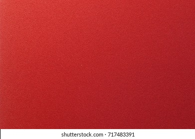 background of fabric or paper of red color with abstract texture