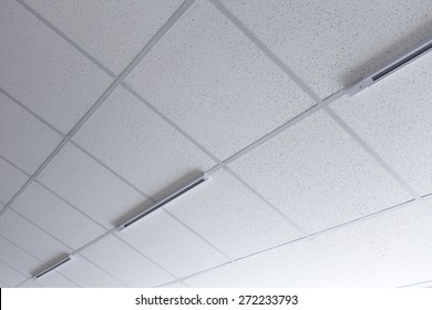 Background of false ceiling with a gallery light attachments.