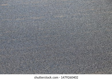 Background with fine tar surface of a new asphalt road. Closeup, Copy space
