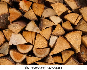 Background of firewood stacked in the woodpile.
