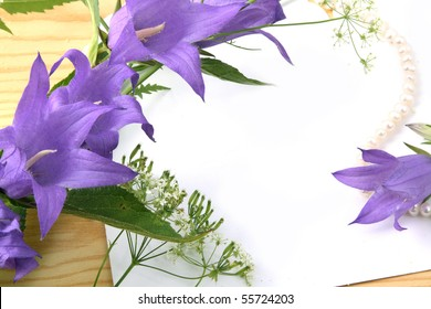 Background with a flower of lilac color and place for the text.