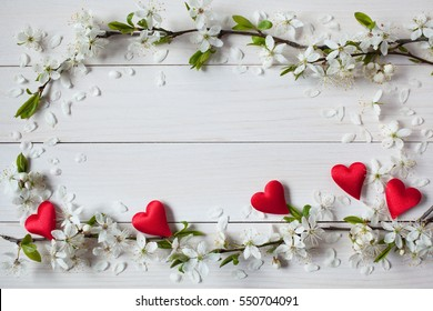 Background with flowering, blooming branches of plums, cherries and red heart