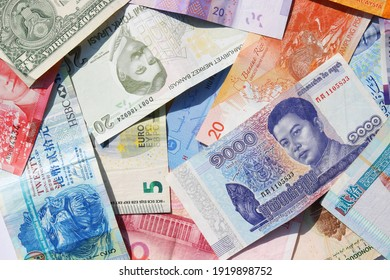 Background of foreign currencies banknotes. Money of the different countries.