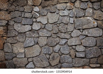 Background in the form of decorative brickwork of gray color