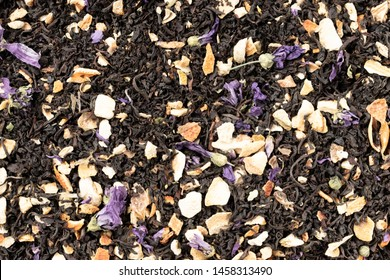 Background in the form of loose leaf tea with orange, mandarin and lemon peel