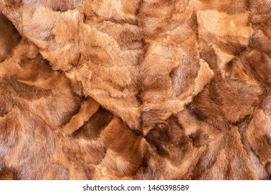 Background in the form of natural pieces of mink fur brown