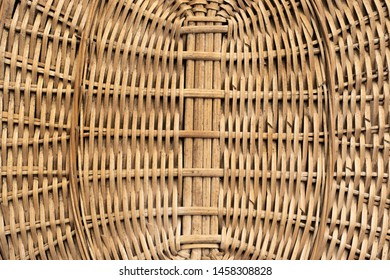 Background in the form of a symmetrical pattern of vertical and horizontal intertwined willow twigs of brown color
