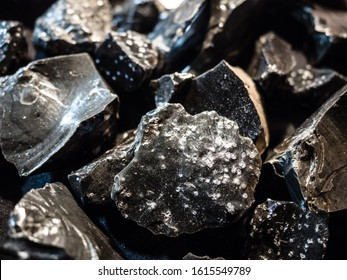 Background formed by pieces of graphite extracted from a mine.