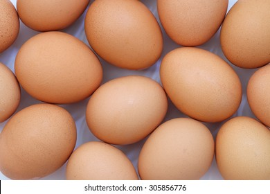Background of fresh brown eggs.