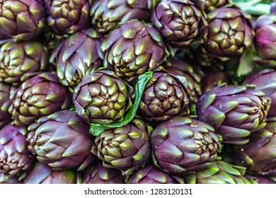 background of fresh purple artichokes