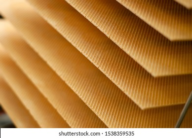 background: freshly baked wafer sheets on a conveyor of a confectionery factory
