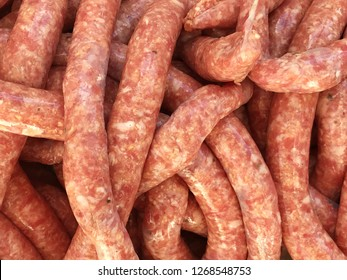 Background of freshly made sausages in one long tube made from freshly ground pork.