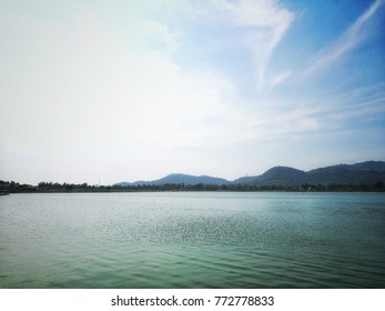 background of Freshness, the Big Swamp Clouds and Blue sky. with the reflection on the water surface.