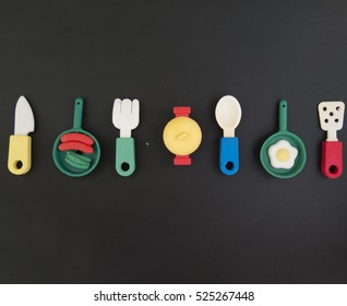 Background of funny and amusing dinner with colored pans and casserole