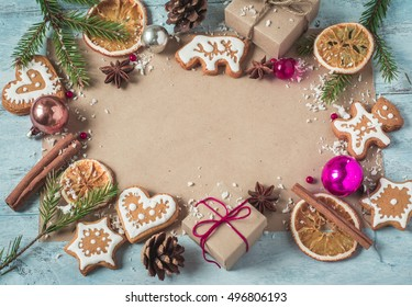 Background gifts, Christmas cookies and fir branches a blue back