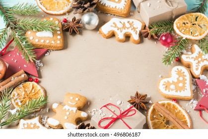Background gifts, fir branches, cones and Christmas cookies