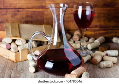 Background with glass of wine, decanter and wine corcs. Wine concept
