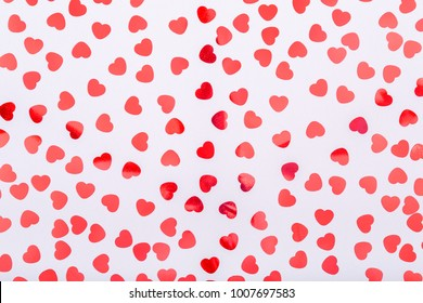Background with glitter heart confetti. Valentine day concept. Trendy minimalistic flat lay design background. Horizontal