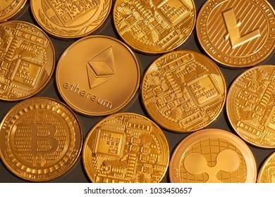 Background of gold coins ripple, bitcoin, litecoin on a dark background