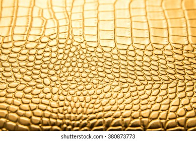 background of gold lizard armor pattern. Snake yellow or golden skin
