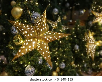 Background of Gold Star light bulb Christmas decoration with disco ball.